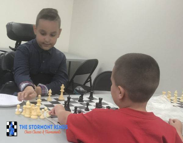 Kids playing chess in Miami